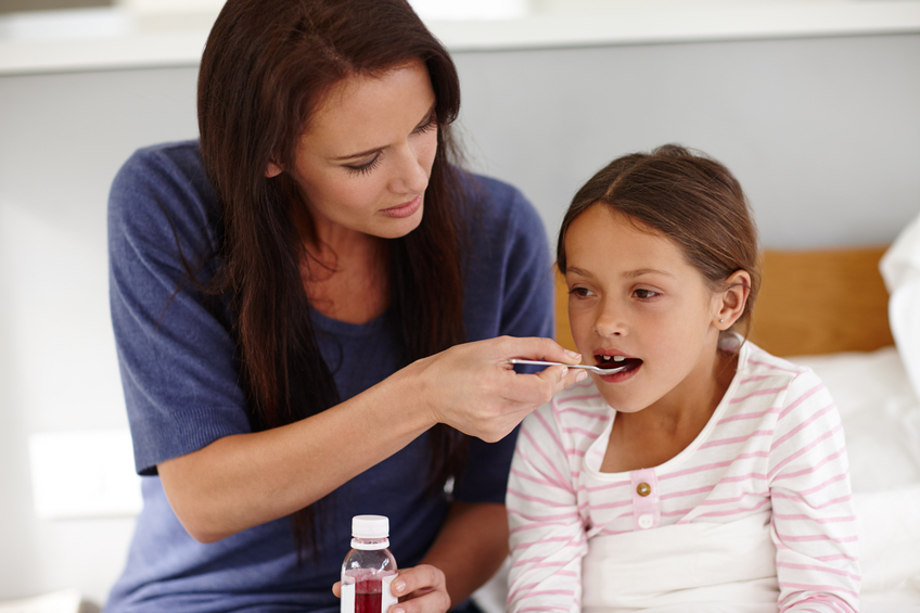 Shot of a caring mother giving her sick little girl a spoonful of medicine http://195.154.178.81/DATA/istock_collage/a4/shoots/785194.jpg